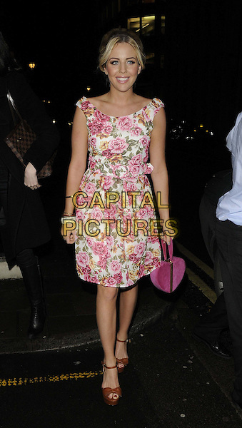 Lydia Rose Bright.attended the 'Ultimate News Quiz' in aid of Action for Children, Quaglino's bar & restaurant, Bury St., London, England, UK, 7th March 2013..full length pink white roses rose floral print vintage retro dress bag brown tan heart shaped novelty handbag platform open toe shoes ankle strap sandals .CAP/CAN.©Can Nguyen/Capital Pictures.