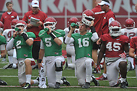 NWA Democrat-Gazette/MICHAEL WOODS &bull; @NWAMICHAELW<br /> University of Arkansas players Rafe Peavey (2) Ty Storey (5) Troy Allison (16) and Tyler Colquitt (45) stretch during practice Saturday August 22, 2015 at Razorback Stadium in Fayetteville.