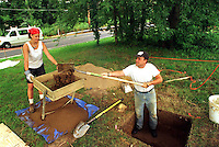 Forrest Hills Cemetery-  A routine archaeological dig has uncovered some prehistoric artifacts at the Lower Moreland cemetery.   Catherine Smyrski, 24, of New Brunswick, NJ. waits as Bill Byrd, 43, (STANDING IN HOLE)of Akron, OH. shovels some dirt into the sifter while they worked on an archaeological dig at Forrest Hills Cemetery in Lower Moreland, PA.