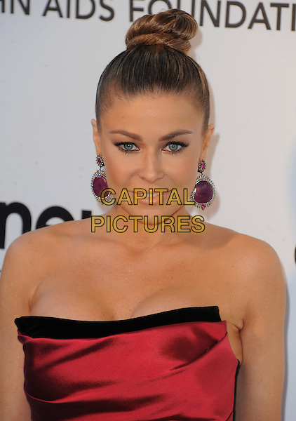 Carmen Electra.The 21st Annual Elton John AIDS Foundation Academy Awards Viewing Party held at The City of West Hollywood Park in West Hollywood, California, USA..February 24th, 2013.oscars headshot portrait purple dangling earrings red strapless silk satin hair up bun .CAP/DVS.©DVS/Capital Pictures.