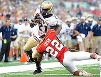 Navy's Gee Gee Greene tries to avoid Terrapins' Cameron Chism. Maryland defeated Navy 17-14 at the M&T Bank in Baltimore, MD on Monday, September 6, 2010. Alan P. Santos/DC Sports Box