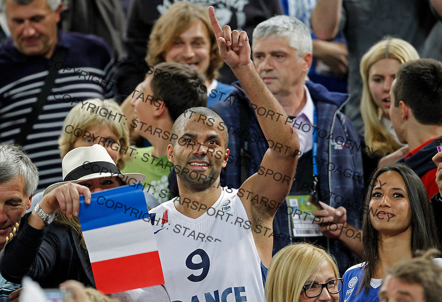 "France`s Tony Parker celebrate with French national basketball team suppoters and his girlfriend Axelle Francine (R) after European basketball championship ""Eurobasket 2013""  final game between France and Lithuania in Stozice Arena in Ljubljana, Slovenia, on September 22. 2013. (credit: Pedja Milosavljevic  / thepedja@gmail.com / +381641260959)"