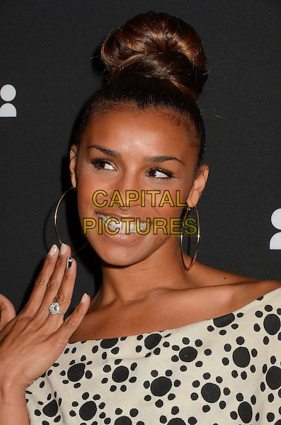 Melody Thornton<br /> The Myspace Event held at The El Rey Theatre in Los Angeles, California, USA.<br /> June 12th, 2013<br /> headshot white top  black pattern hair up bun hoop earrings smiling hand ring<br /> CAP/ADM/BT<br /> &copy;Birdie Thompson/AdMedia/Capital Pictures