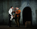 """English Touring Opera presents """"Don Giovanni"""", by Wolfgang Amadeus Mozart, at the Hackney Empire.  Directed by Lloyd Wood, with set & costume design by Anna Fleischle and lighting design by Guy Hoare. Picture shows:  George von Bergen (Don Giovanni), Matthew Stiff (Leporello)."""