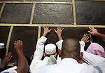 Muslim pilgrims touch the holly Kaaba located in the center of the Haram Sharif Great Mosque, during the Muslim's Hajj 2014 pilgrimage, in Mecca, Saudi Arabia, 25 September 2014. According to the Muslims holly book the Koran, the Kaaba was built by Abraham and his son Ismael, after Ismael had settled in Arabia. Millions of Muslims have arrived in Saudi Arabia to perform their Hajj. Photo by Ashraf Amra