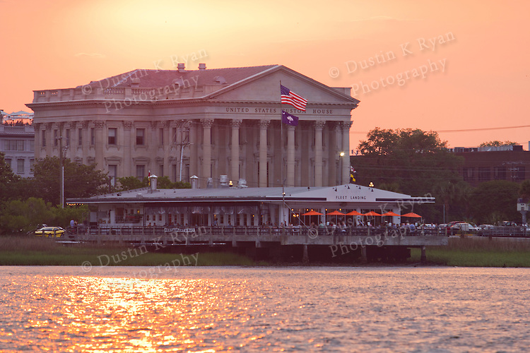 Sunset over the united states custom house and fleet landing restaurant on the Charleston Harbor South Carolina