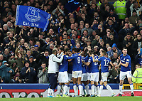 29th October 2019; Goodison Park, Liverpool, Merseyside, England; English Football League Cup, Carabao Cup Football, Everton versus Watford; Mason Holgate of Everton celebrates with his team mates in front of supporters at the Gwladys Street end after scoring the opening goal after 72 minutes - Strictly Editorial Use Only. No use with unauthorized audio, video, data, fixture lists, club/league logos or 'live' services. Online in-match use limited to 120 images, no video emulation. No use in betting, games or single club/league/player publications