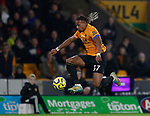 Adama Traore of Wolverhampton Wanderers leaps up to control the ball during the Premier League match at Molineux, Wolverhampton. Picture date: 14th February 2020. Picture credit should read: Darren Staples/Sportimage