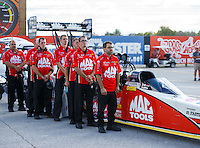 Sep 3, 2016; Clermont, IN, USA; Crew members stand alongside the dragster of NHRA top fuel driver Doug Kalitta during the national anthem prior to qualifying for the US Nationals at Lucas Oil Raceway. Mandatory Credit: Mark J. Rebilas-USA TODAY Sports