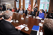 United States President Barack Obama speaks at a Cabinet Meeting  in the Cabinet Room at the White House in Washington, DC., Monday, October 3, 2011.  From left to right: Administrator of the U.S. Environmental Protection Agency, Lisa Jackson; U.S. Secretary of Education Arne Duncan; U.S. Secretary of Health and Human Services Kathleen Sebelius; U.S. Secretary of the Interior Ken Salazar; U.S. Secretary of State Hillary Rodham Clinton; President Obama; U.S. Secretary of Transportation Ray LaHood; U.S. Secretary of Homeland Security Janet Napolitano..Credit: Olivier Douliery / Pool via CNP