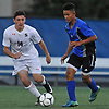 Michael Andre #14 of Syosset, left, Axel Camas #6 of Long Beach battle for possession during the Nassau County varsity boys soccer Class AA semifinals at Hofstra University on Thursday, Oct. 27, 2017. Andre scored the first of two goals in Syosset's 2-0 win.