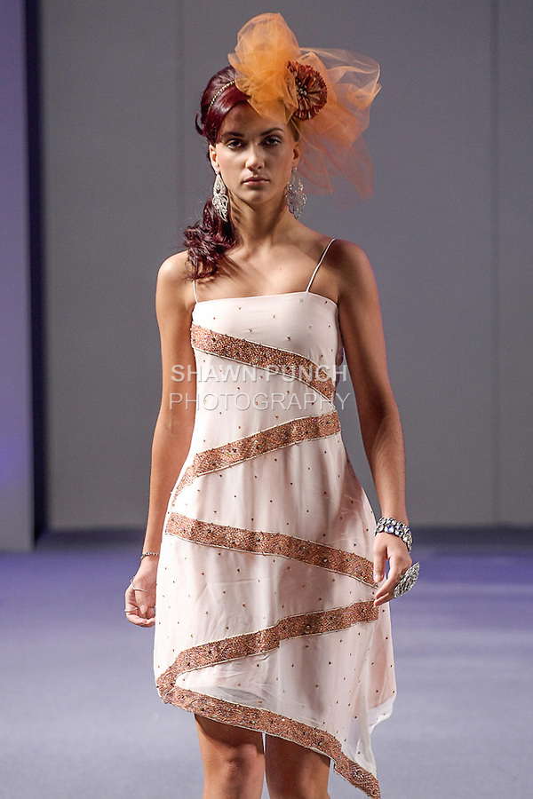 Model walks runway in an outfit from the Sumbul's Collection fashion show by Sumbul Rizvi, during Couture Fashion Week Spring 2013 in NYC, on September 16, 2013.