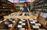 A wine trader holds a 1.5 litre bottle of Moulin de Duhart Paulliac 2009 which sells for RMB7,330.00 at the official Chinese government-owned Guangzhou Friendship Store across town. But she was selling it for just RMB1,230.00 – about a hundred pounds.<br /> <br /> <br /> PHOTO BY SINOPIX