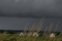 Dark rain clouds pass by during Matchplay Round 1 of the South of Ireland Amateur Open Championship at LaHinch Golf Club on Friday 22nd July 2016.<br /> Picture:  Golffile | Thos Caffrey<br /> <br /> All photos usage must carry mandatory copyright credit   (© Golffile | Thos Caffrey)