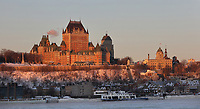 Chateau Frontenac, opened 1893, designed by Bruce Price as a chateau style hotel for the Canadian Pacific Railway company or CPR, with the Saint Lawrence river below, in Quebec City, Quebec, Canada. The building was extended and the central tower added in 1924, by William Sutherland Maxwell. The building is now a hotel, the Fairmont Le Chateau Frontenac, and is listed as a National Historic Site of Canada. The Historic District of Old Quebec is listed as a UNESCO World Heritage Site. Picture by Manuel Cohen