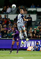 1st February 2020; HBF Park, Perth, Western Australia, Australia; A League Football, Perth Glory versus Melbourne Victory; Ola Toivonen of Melbourne Victory wins the header against Neil Kilkenny of the Perth Glory