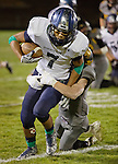 Damonte Ranch Mustangs receiver Elijah Sapico is tackled by Galena Grizzlies line backer Nate King during their football game played on Thursday night, October 29, 2015 in Reno, Nevada.