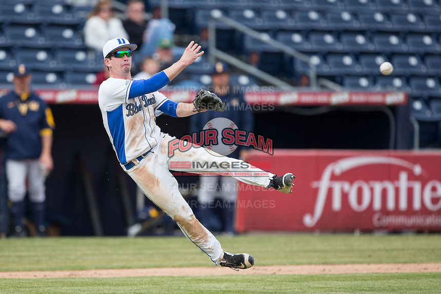 Duke Blue Devils third baseman Max Miller (5) makes a throw to first base against the California Golden Bears at Durham Bulls Athletic Park on February 20, 2016 in Durham, North Carolina.  The Blue Devils defeated the Golden Bears 6-5 in 10 innings.  (Brian Westerholt/Four Seam Images)