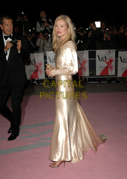 KATE MOSS, MARIO TESTINO.V&A Golden Age of Couture Gala.Victoria and Albert museum.18th September 2007 London, England.full length gold cream satin silk dress clutch bag open-toe shoes behind taking photo camera train.CAP/PL.©Phil Loftus/Capital Pictures