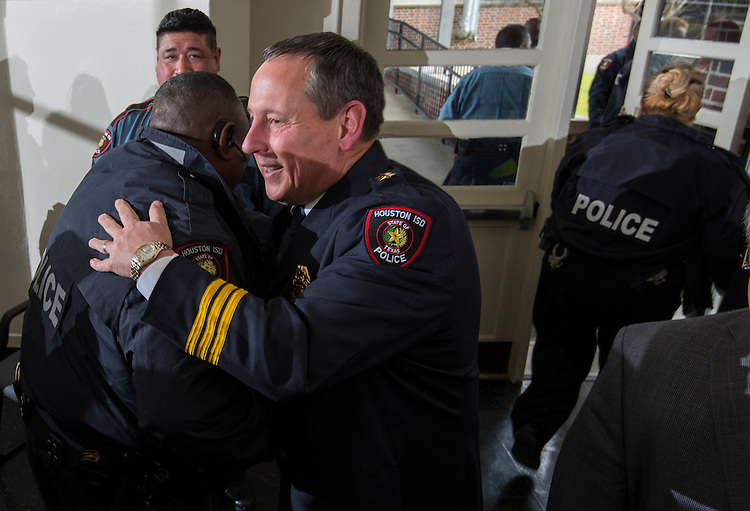 Houston ISD Chief of Police Robert Mock, right, greets attendees after being sworn into office, January 6, 2014, at the High School for Law Enforcement and Criminal Justice.