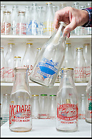 BNPS.co.uk (01202 558833)<br /> Pic: RachelAdams/BNPS<br /> <br /> One of Peter's favourite bottles. <br /> <br /> In a glass of his own...<br /> <br /> Dairy-daft Peter Hayward is udderly devoted to his bizarre hobby - collecting vintage milk bottles.<br /> <br /> The 70-year-old has devoted the last 30 years to building up a whopping collection of more than 1,000 bottles.<br /> <br /> Peter, a former dairy worker, scours the south west of Britain in search of rare bottles emblazened with the colourful logos of old dairies.<br /> <br /> And since retiring 16 years ago his collection has swelled so much that he has been forced to turn his garage into a mini museum.<br /> <br /> Peter's obsession with milk started as a 10-year-old when he helped his local milkman on his weekend rounds to earn some pocket money.<br /> <br /> He later joined Express Dairies as a distribution manager, working alongside hundreds of independent dairy farmers.<br /> <br /> When he retired in the late 1990s Peter had amassed a sizeable collection in his office - and decided to devote his free time to growing it.