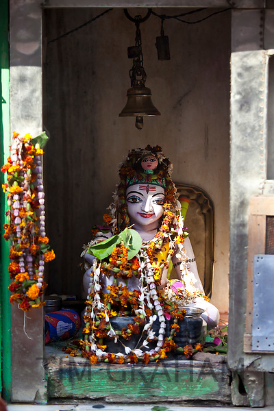 Religious icon on display during Festival of Shivaratri in temple window in the city of Varanasi, Benares, Northern India