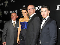 WWW.BLUESTAR-IMAGES.COM (L-R) Bovet 1822 owner Pascal Raffy, actress Kate Beckinsale, writer/director Paul Haggis and musician Kevin Jonas arrive at the Hollywood Domino's 7th Annual Pre-Oscar Charity Gala at Sunset Tower on February 27, 2014 in West Hollywood, California.<br /> Photo: BlueStar Images/OIC jbm1005  +44 (0)208 445 8588