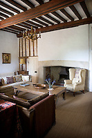 The living room is dominated by the restored stone fireplace