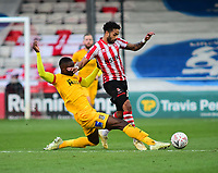 Northampton Town's Hakeem Odoffin vies for possession with  Lincoln City's Bruno Andrade<br /> <br /> Photographer Andrew Vaughan/CameraSport<br /> <br /> Emirates FA Cup First Round - Lincoln City v Northampton Town - Saturday 10th November 2018 - Sincil Bank - Lincoln<br />  <br /> World Copyright © 2018 CameraSport. All rights reserved. 43 Linden Ave. Countesthorpe. Leicester. England. LE8 5PG - Tel: +44 (0) 116 277 4147 - admin@camerasport.com - www.camerasport.com