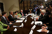 United States President Barack Obama meets with small business owners to discuss the importance of the reauthorization of the Export-Import Bank in the Roosevelt Room of the White House, July 22, 2015, in Washington, DC. <br /> Credit: Aude Guerrucci / Pool via CNP