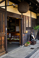 "Takayama Sake Shop - The Cedar Ball means ""sake brew is ready"" and called a sugidama.  Takayama is well known for its quality sake, in part because of the pure waters in the region."