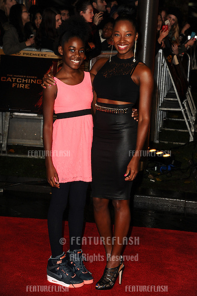 "Jameelia and her daughter arriving for the World Premiere of ""The Hunger Games: Catching Fire"" in Leicester Square, London. 11/11/2013 Picture by: Steve Vas / Featureflash"
