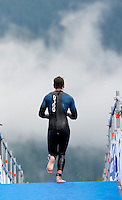 11 JUL 2009 - KITZBUHEL, AUT - A competitor heads for transition - Jedermann Triathlon (PHOTO (C) NIGEL FARROW)