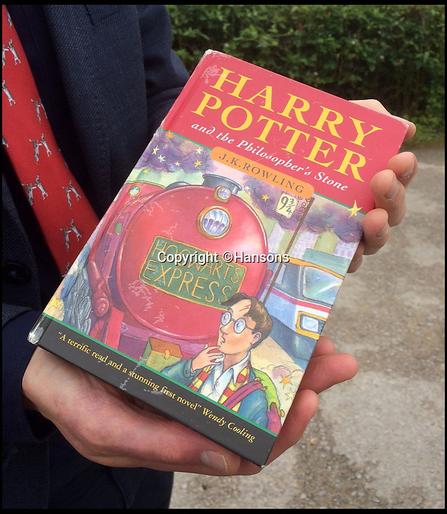 BNPS.co.uk (01202 558833)<br /> Pic: Hansons/BNPS<br /> <br /> £1 boot fair Potter could sell for £30,000!<br /> <br /> An incredibly rare 1st edition of Harry Potter and the Philosophers Stone, that was withdrawn from sale due to typo faults, is set to sell for £30,000 at auction after being bought for only £1 by its lucky owner.<br /> <br /> Eagle-eyed auctioneer Jim Spencer from Hansons spotted the super rare cover amongst boxes of old books at a valuation - the lucky owner had no idea of its magic value.<br /> <br /> The much sought after title is now being sold by the Derbyshire auctioneers ion 31/8/19.
