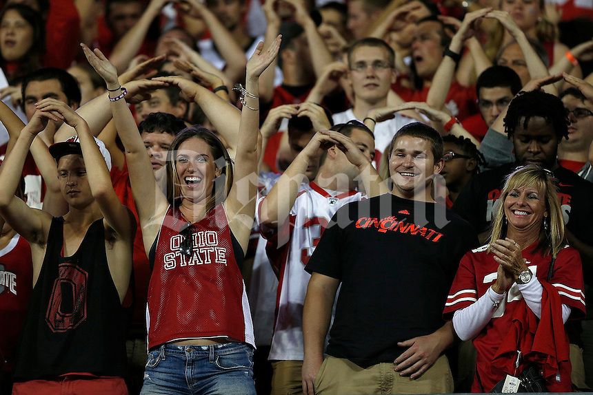 A lone Cincinnati fan tries to enjoy himself with the Buckeye faithful during the fourth quarter of Saturday's NCAA Division I football game at Ohio Stadium in Columbus on September 27, 2014. (Columbus Dispatch photo by Jonathan Quilter)