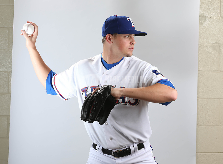 Feb. 20, 2013; Surprise, AZ, USA: Texas Rangers pitcher Coty Woods poses for a portrait during photo day at Surprise Stadium. Mandatory Credit: Mark J. Rebilas-