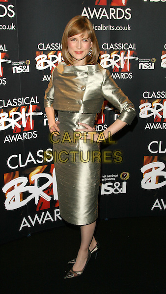 KATIE DERHAM.The Classical Brit Awards Nominations Party at The Landmark Hotel, London..April 21st, 2004.full length hands on hips silver metallic dress.www.capitalpictures.com.sales@capitalpictures.com.©Capital Pictures.