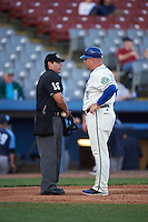 Hartford Yard Goats manager Darin Everson (41) discusses a call with umpire Jorge Teran during the second game of a doubleheader against the Trenton Thunder on June 1, 2016 at Sen. Thomas J. Dodd Memorial Stadium in Norwich, Connecticut.  Trenton defeated Hartford 2-1.  (Mike Janes/Four Seam Images)