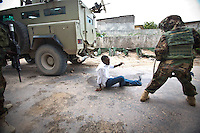 A member of the Somali National Army, in plane clothes, hits the floor seconds after being shot by al-Shabaab militants.
