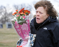 Rosemary Stewart holds flowers as she visits the grave of her son, Matthew Stewart Thursday, February 2, 2017 at All Saints Cemetery in Newtown, Pennsylvania. Stewart had purchased a family plot, and the cemetery people placed her son's gravesite too close to the street, leaving the family unable to place the tombstone they had chosen. After much back and forth the cemetery agreed to move the casket over to the next plot further away from the street, thus enabling the tombstone to be placed at the grave. (WILLIAM THOMAS CAIN / For The Philadelphia Inquirer)