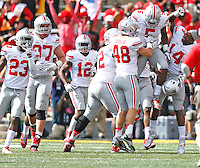 OSU teammate celebrate with *Ohio State Buckeyes linebacker Raekwon McMillan (5) after an interception in the second half at Byrd Stadium on October 4, 2014.  (Chris Russell/Dispatch Photo)