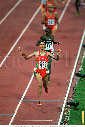 HICHAM EL GUERROUJ (MAR) wins the Mens 1500m Gold Medal, World Athletics Championships, Seville, 990824. Photo: Glyn Kirk/Action Plus...distance.winner.celebration.joy.1999.man.track and field.male