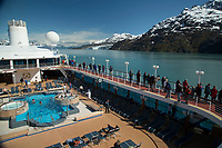 Visitors aboard Pacific Princess Cruise ship view Mount Cooper and Lamplugh Glacier in Johns Hopkins Inlet in Glacier Bay National Park in Southeast, Alaska    No Model Releases<br /> <br /> (C) Jeff Schultz/SchultzPhoto.com