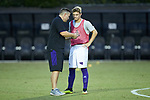 High point Panthers head coach EJ O'Keeffe talks to Nick Phipps (22) prior to the game against the Wake Forest Demon Deacons at W. Dennie Spry Soccer Stadium on October 9, 2018 in Winston-Salem, North Carolina. The Demon Deacons defeated the Panthers 4-2.  (Brian Westerholt/Sports On Film)