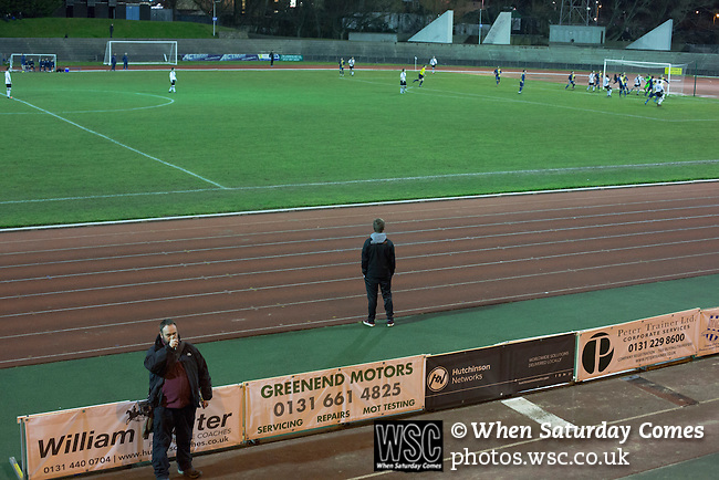 Edinburgh City 1 East Kilbride 1, 12/03/2016. Meadowbank Stadium, Scottish Lowland League. GroundhopUK organisers Laurence Reade counting the crowd at Meadowbank Stadium during the final game of four Saturday fixtures as Edinburgh City take on East Kilbride in a Scottish Lowland League match which ended 1-1. The match was one of six attended by members of GroundhopUK over the weekend to accommodate groundhoppers, fans who attempt to visit as many football venues as possible. Around 100 fans in two coaches from England participated in the 2016 Lowland League Groundhop and they were joined by other individuals from across the UK which helped boost crowds at the six featured matches. Photo by Colin McPherson.