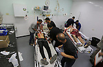 A Palestinian role-playing as an injured person is transported on a moving hospital bed into a hospital during an emergency drill for treating mass casualties organised by French humanitarian organisation Medecins du Monde (Doctors of the World), at the European Gaza Hospital in Khan Yunis in the southern Gaza Strip on September 16, 2019.. Photo by Ashraf Amra