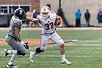 Wisconsin Badgers running back Garrett Groshek (37) stiff arms a defender during an NCAA College Big Ten Conference football game against the Illinois Fighting Illini Saturday, October 28, 2017, in Champaign, Illinois. The Badgers won 24-10. (Photo by David Stluka)