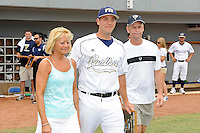 16 May 2010:  FIU's Scott Rembisz (30) and family make their way onto the field prior to the game as FIU honored its seniors.  The FIU Golden Panthers defeated the University of South Alabama Jaguars, 5-0, at University Park Stadium in Miami, Florida.