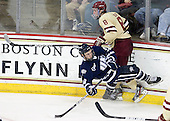 Matt Willows (UNH - 9), Edwin Shea (BC - 8) - The Boston College Eagles defeated the visiting University of New Hampshire Wildcats 4-3 on Friday, January 27, 2012, in the first game of a back-to-back home and home at Kelley Rink/Conte Forum in Chestnut Hill, Massachusetts.