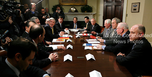 U.S. President George W. Bush (3R) speaks to the media after a meeting with members of Securing America's Future Energy in the Roosevelt Room of the White House in Washington, DC Monday 29 January 2007.